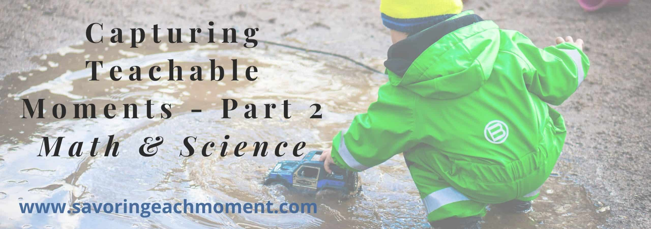 Young child wearing a green rain jacket, playing in a puddle